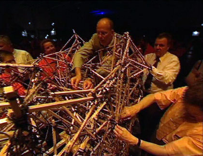 Knotting 4000 sticks to form a self-supporting bridge