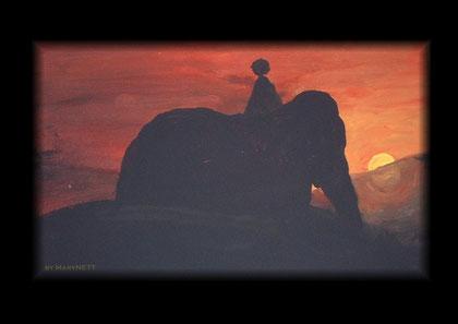Kind reitet auf einem Elefanten