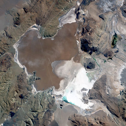 Salar del Hombre Muerto, in northwestern Argentina. A salar is a salt pan, created when water repeatedly evaporates from a shallow lake, leaving behind a crusty layer of salt minerals, which are brilliant white in  EO-1 satellite image.©NASA GSFC.