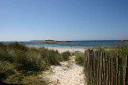 the beach, at the background, the seven islands