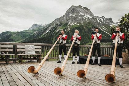 """The """"Lecher Alphornbläser"""" playing at the Rudalpe above Lech"""