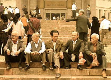 Old men chewing the fat in the grounds of the Presidential Palace Grounds, Hanoi, Vietnam