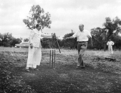 Meher Baba handing the bat to Sarosh Irani