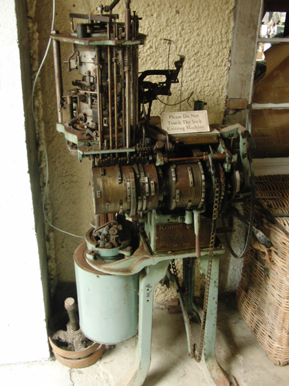 Historic sock knitting machine at Solva Woollen Mill in Wales