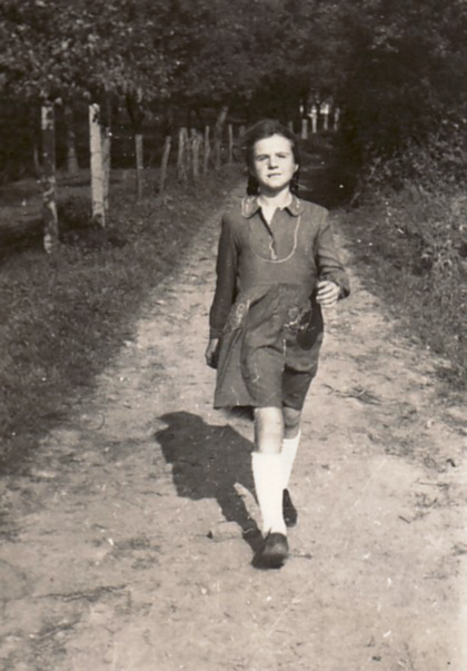 "The young Bettina Heinen in the famine year of 1947 on the way from the Black House in Solingen to the nearby ""artist garden"" of the Heinen family"