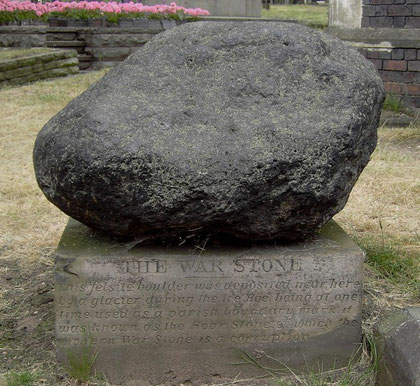 """The War Stone - This felsite boulder was deposited near here by a glacier during the Ice Age; being at one time used as a parish boundary mark, it was known as the Hoar Stone of which the modern War stone is a corruption."""