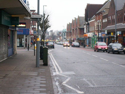 Kings Heath High Street looking north. Copyright Phil Champion and licensed for reuse under Creative Commons Licence: Attribution-Share Alike 2.0 Generic. Geograph OS reference SP0781.
