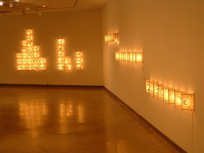 """Installation detail, Self Hand made paper, wood, ink and lights, 84""""x204""""x 6"""", 2004 - 2006"""