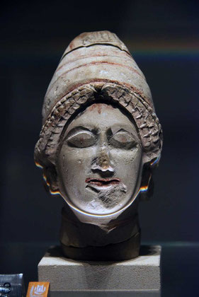Limestead head of man with bonnet mid 5th century BC, Pierides Collection, Nicosia