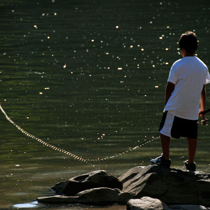 Boy fishing in the Potomac above Georgetown