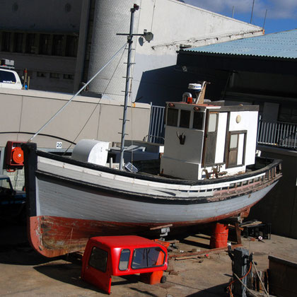 Hauled out fishing boat in the Alfred Basin, Cape Town harbour