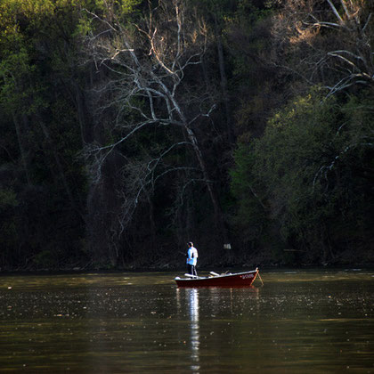 Guy fishing in the Potomac above Georgetown