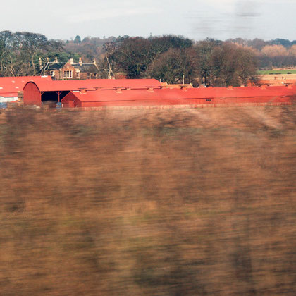 Farm toun with characteristic oxide-red roofs