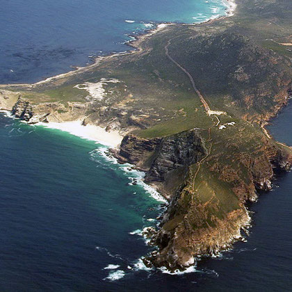 Aerial view of Cape Point (nearest) and the Cape of Good Hope (left) (Courtesy Bgabel at wikivoyage shared)