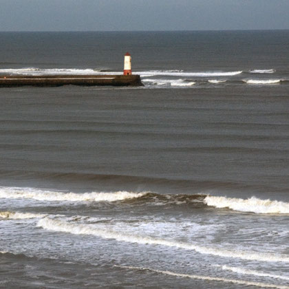 Surf at Berwick-upon-Tweed mole (from the Latin moles meaning large mass - same root as molecule)