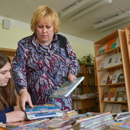 Заведующая библиотекой Романюк Жанна Сергеевна