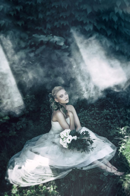 Fashion photography, a dreaming bride sit on the grass by Monica Monimix Antonelli