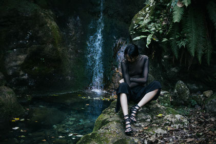 Fashion photography, a woman in front of a waterfall by Monica Monimix Antonelli