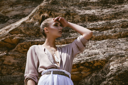Fashion photography, a woman in front of a rocks wall by Monica Monimix Antonelli