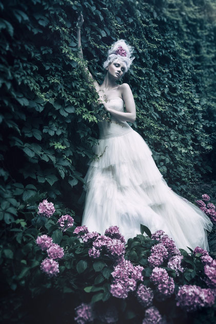 Fashion photography, a bride on the flowers by Monica Monimix Antonelli
