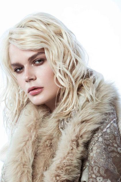 Blonde model with coat