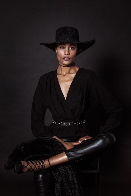 Fashion portrait of a black model with black clothes