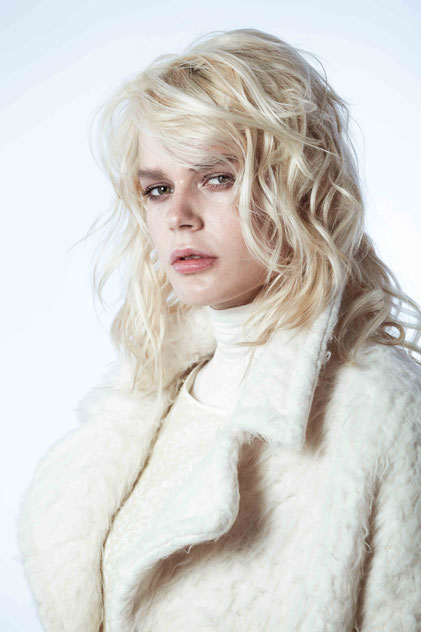 Blonde model with white coat