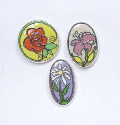 The front of the Flower set.  Cloisonné Enamel on Copper and set in sterling silver.