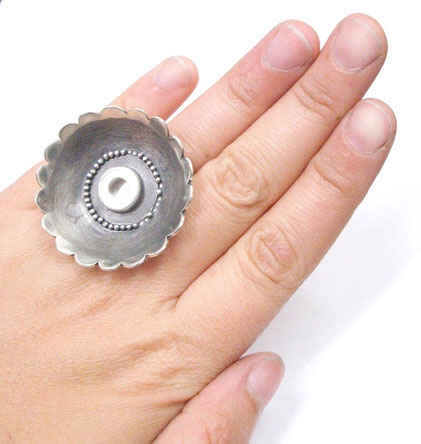 "Flower ring worn ""bare.""  You can see the magnet set in the center."