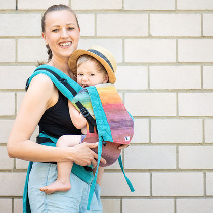 Huckepack Half Buckle baby carrier, made from a Girasol wrap, adjustable panel, well padded straps, ergonomic hipbelt.