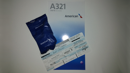 My boarding pass, salt pretzels and a safety card from the A321