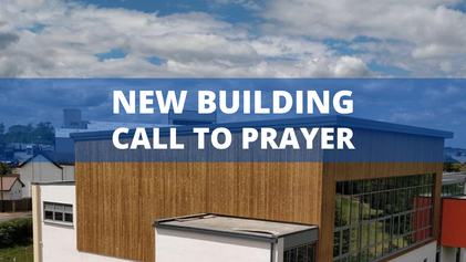 New Building Call to Prayer over a large modern building and blue sky