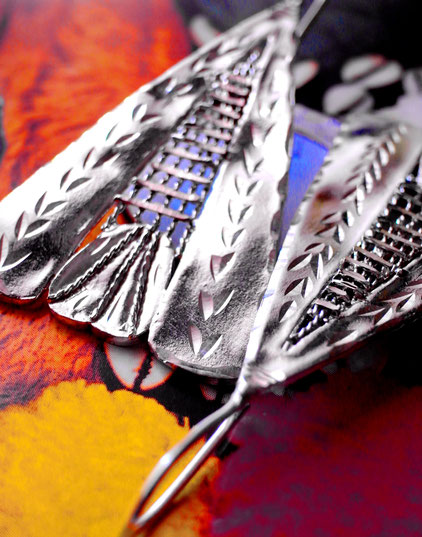 Prajapati: triangular, sterling-silver earrings, close-up
