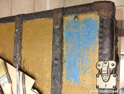 toile Louis Vuitton repeinte en jaune et bleu