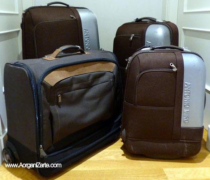 En una mudanza guarda la ropa en maletas - www.AorganiZarte.com