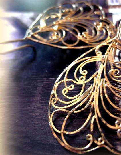Dhupa earrings: 24kt, gold-dipped, sterling-silver, flat-wire-framed, ornate filigree; close-up of swirls