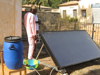 Boiling water from the sun (water disinfection) using a solar collector (Togo)