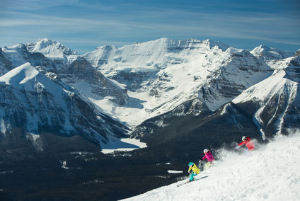 Three people skiing in Lake Louise in Banff National Park Alberta