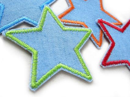 Bild: Hosenlöcher nachhaltig reparieren mit kleinen Stern Flicken zum aufbügeln