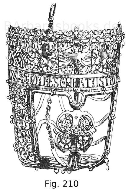 """Fig. 210. Pferdemaulkorb aus verzinntem Eisen, teils durchbrochen, teils mit Drahtgittern ausgestattet. Auf einem Band zeigt sich die Inschrift: """"Was got beschert, ist vnerwert"""". Zweite Hälfte des 16. Jahrhunderts. Sammlung Franz Thill in Wien."""