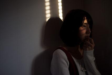 腰痛に悩む奈良県香芝市の女性