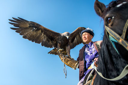 Ruslan jumped on his horse and was posing for us with his eagle