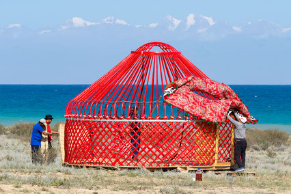 Setting down the yurt in front of Issyk Kul Lake, Kyrgyzstan