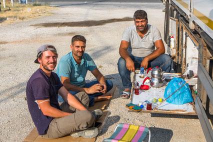 Abdul, his truck friend and Bastian having tea break
