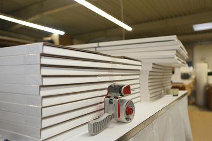 Kartons selbst produziert für den Filialversand