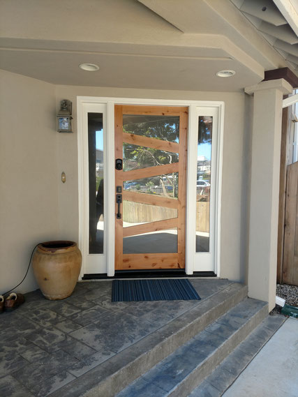After new prehung fiberglass door staining, painting and installation