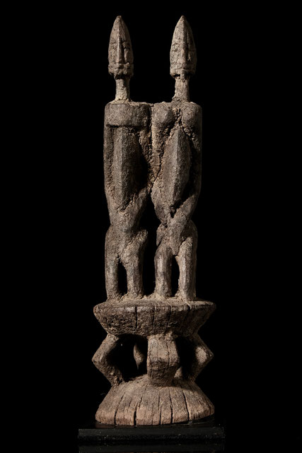 Very old Dogon Couple with crusty patina, kneeing close together on an altar.