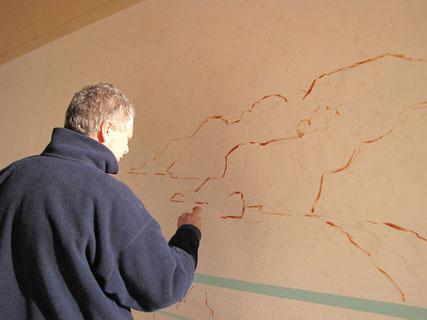 Tony trace au pinceau les lignes faite au crayon.
