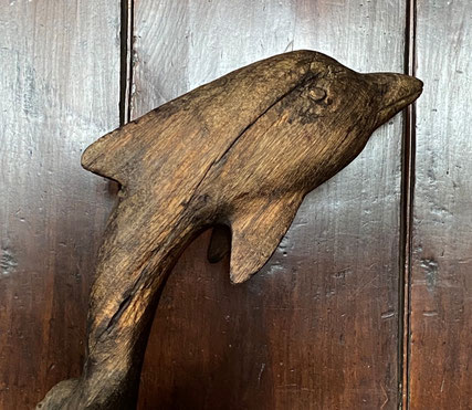 Naive and Primitive Weathered Model of a Dolphin
