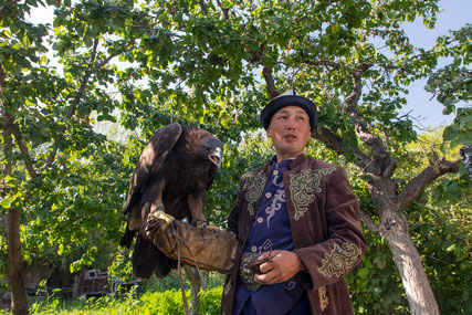 Ruslan with his 12 year old eagle in the backyard of his house in Bokonbaevo